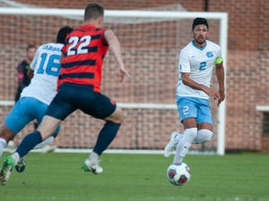 UNC senior midfielder and captain Mauricio Pineda (2) runs toward the ball at the first round of the ACC tournament against Syracuse at Dorrance Field on Tuesday, Nov. 5, 2019. UNC lost to Syracuse 3-5.