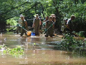 A group of students work in the Eno River. Photo Courtesy of Holly Reid.