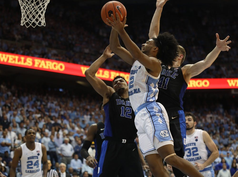 First-year Coby White leads No. 3 UNC to senior night victory over No. 4 Duke