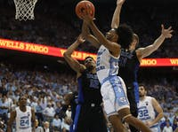 First-year guard Coby White (2) attempts a layup against Duke in the Smith Center on Saturday, March 9, 2019. UNC defeated Duke 70-79 on Senior Night to finish the season as ACC regular season champions.