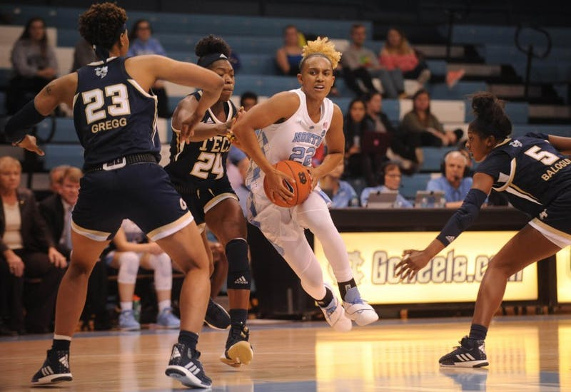 Guard Paris Kea (22) drives against Georgia Tech in Carmichael Arena on Thursday, Jan. 31, 2019. UNC won 91-90.