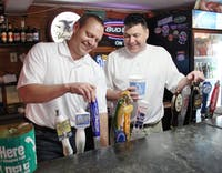 """Matt Mehok, left,  and Bennett Roberts officially announced that they are the new owners of the bar He's Not Here, after deciding to buy it in mid-January. """"We have dedicated ourselves to being a part of this bar,"""" said Mehok. They are working on getting the design of the iconic cup just right."""