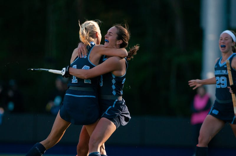 Senior Marissa Creatore (33) celebrates fellow Senior Faline Guenther's (14) game-winning goal in the second overtime of Carolina's 3-2 victory of Saint Joseph's University on Sunday, Nov. 3, 2019. The team's 40th straight win came on the last game of the regular season, sealing their second-straight undefeated regular season.