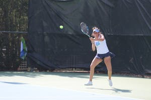 Sophomore Alexa Graham hits a backhand against Virginia on April 13 at the Cone-Kenfield Tennis Center.