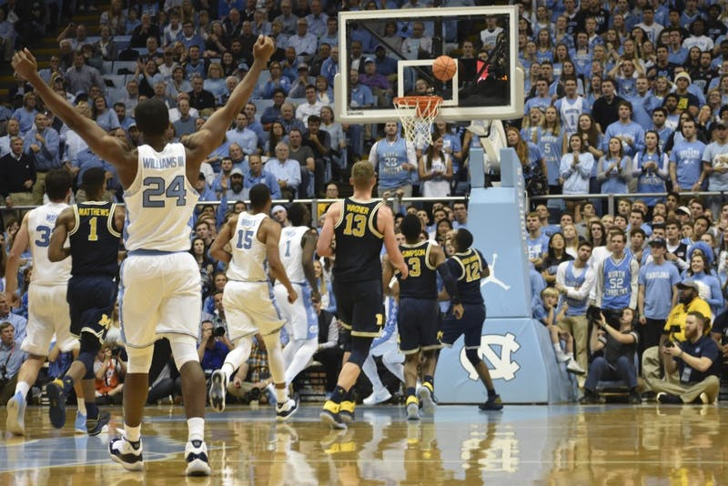 Guard Kenny Williams (24) watches a last-second first-half shot against Michigan in the Smith Center.