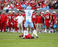 Cornerback Patrice Rene (5) celebrates after a pass breakup against N.C. State on Nov. 25 in Raleigh.