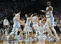 The North Carolina men's basketball team celebrates after defeating Gonzaga, 71-65, in the national championship game in April in Glendale, Ariz.