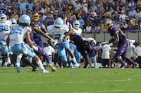 UNC tailback Jordon Brown (2) pushes through ECU players on Sept. 8, 2018 at Dowdy-Ficklen Stadium.