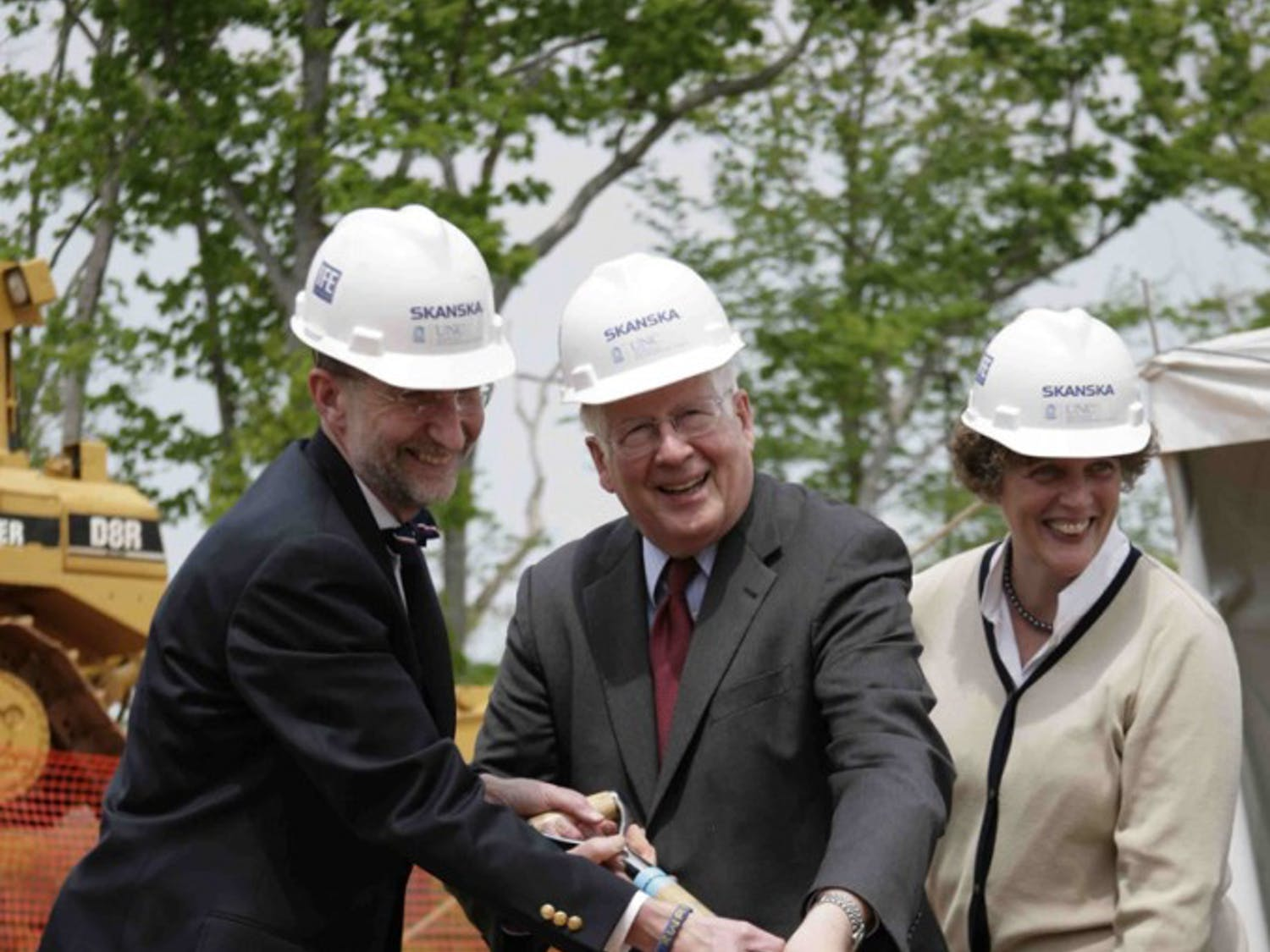 Dr. Bill Roper, CEO of UNC Health Care , and U.S. Rep. David Price, D-NC, share a shovel during the ceremonial ground breaking at the UNC Health Care Hillsborough Campus.