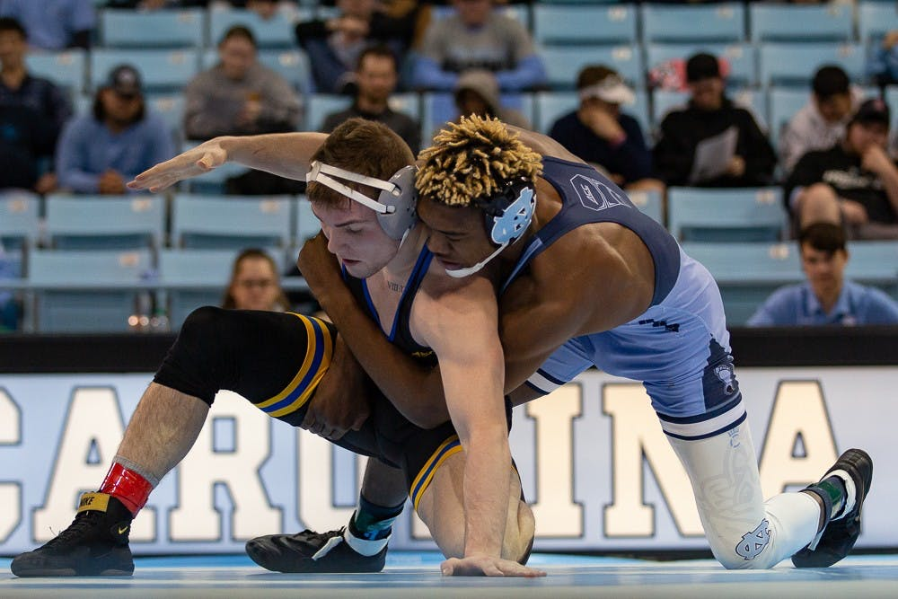 <p>UNC's redshirt junior Kennedy Monday wrestles Pittsburgh redshirt junior Jake Wentzel in Carmichael Arena on Friday, Feb. 14, 2020. North Carolina beat No. 9 Pittsburgh 22-14.</p>
