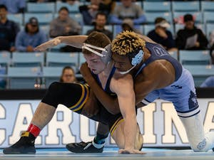 UNC's redshirt junior Kennedy Monday wrestles Pittsburgh redshirt junior Jake Wentzel in Carmichael Arena on Friday, Feb. 14, 2020. North Carolina beat No. 9 Pittsburgh 22-14.