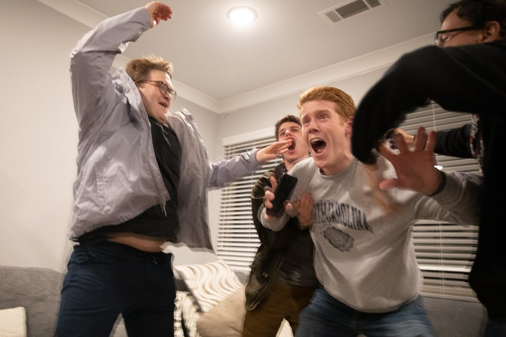 <p>Student Body President-Elect Reeves Moseley (third from left) reacts to learning that he won the vote for student body president in an apartment in Carolina Square on Wednesday, Feb. 11, 2020. Moseley won about 70% of the vote.</p>