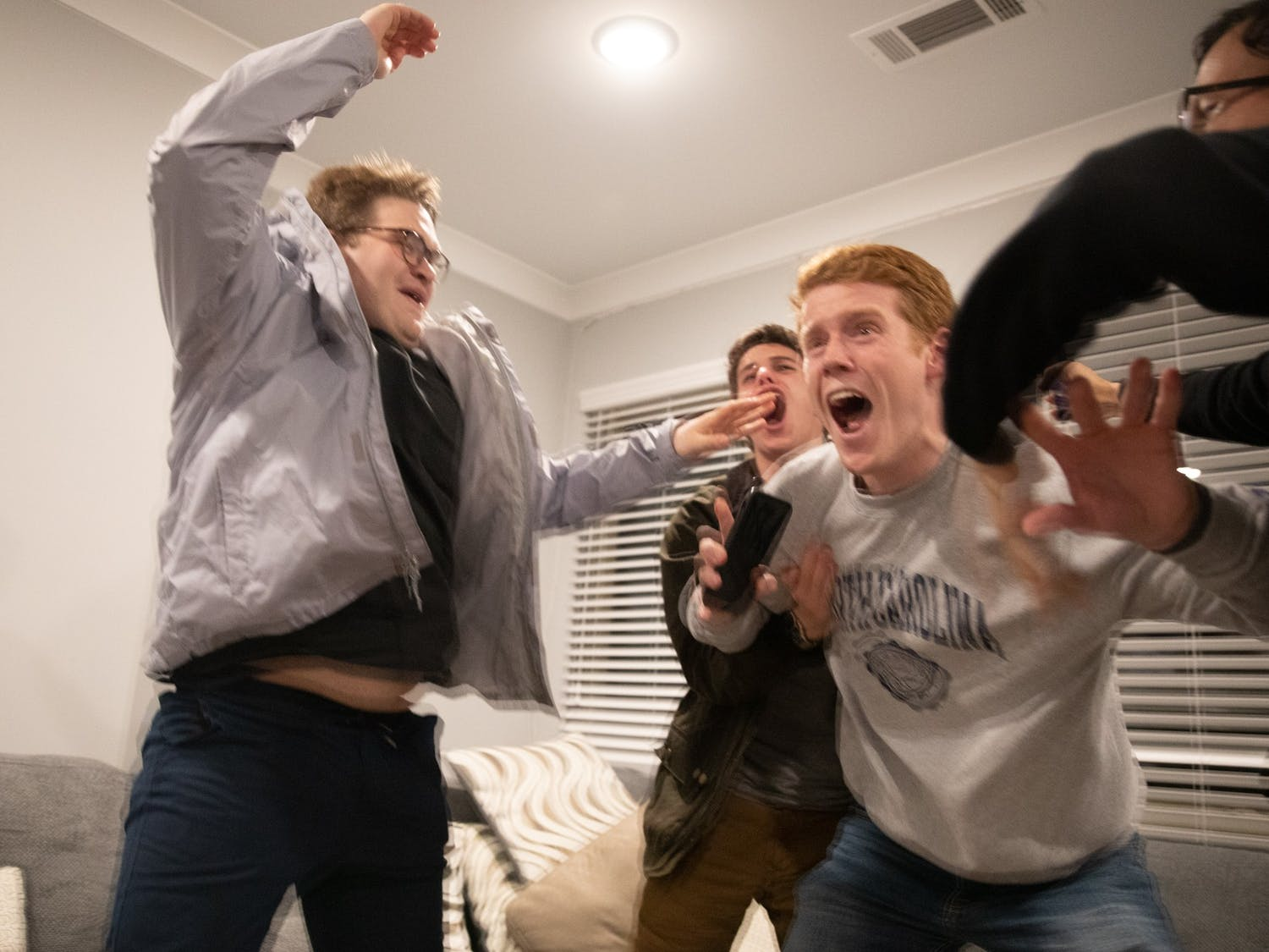 Student Body President-Elect Reeves Moseley (third from left) reacts to learning that he won the vote for student body president in an apartment in Carolina Square on Wednesday, Feb. 11, 2020. Moseley won about 70% of the vote.