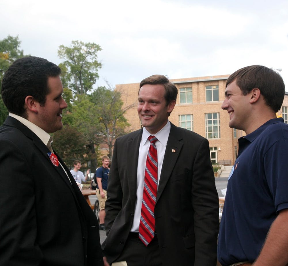College Republicans President Anthony Dent (right) speaks with B.J. Lawson, who is running for U.S. Rep. David Price's seat, at Rock the Vote in Frat Court. Both College Republicans and Young Democrats gathered.