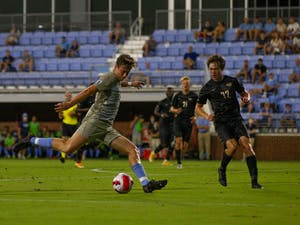 UNC graduate student midfielder Chris Sullivan (41) strikes the ball at the soccer game against Virginia Commonwealth on Aug. 29 in Chapel Hill. UNC tied 1-1.