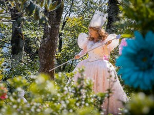 Glinda the Good Witch prepares to greet patrons before they embark on their journey down the Yellow Brick Road at the Land of Oz on Sept. 12.