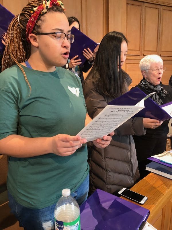 Alexx Andersen participates in the Wake Forest Baptist Church's choir practice at Wait Chapel.