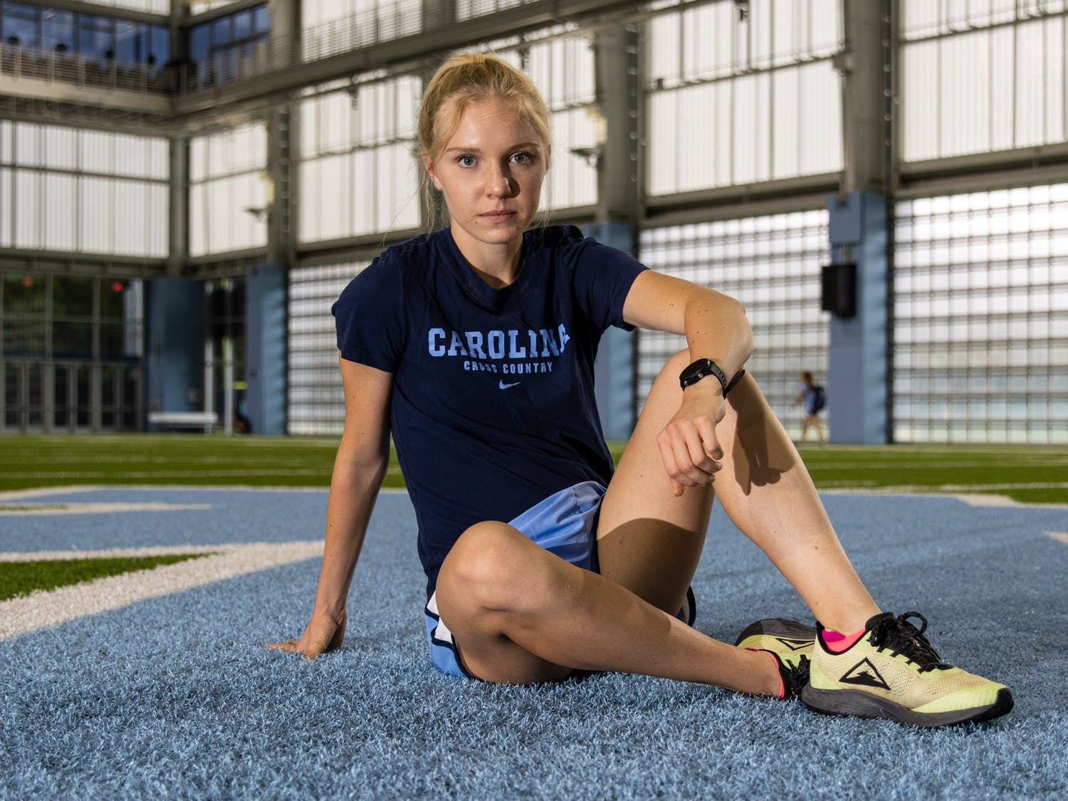 Brynn Brown is a first-year cross-country runner from Denton, Texas. She poses for a portrait before an afternoon practice in the Bill Koman Practice Complex on Oct. 4.