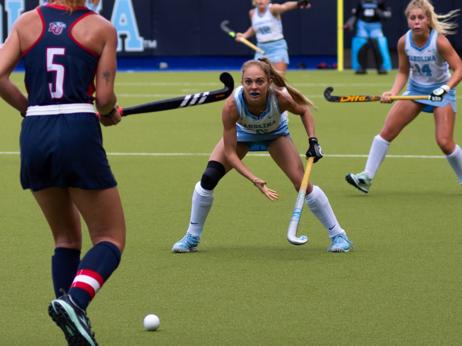 Senior midfielder Abby Pitcairn (16) waits to defend against a Liberty player during UNC's Oct. 10 field hockey game against Liberty. The game proved to be a loss for the Tar Heels–Liberty headed home with a 4-0 win.