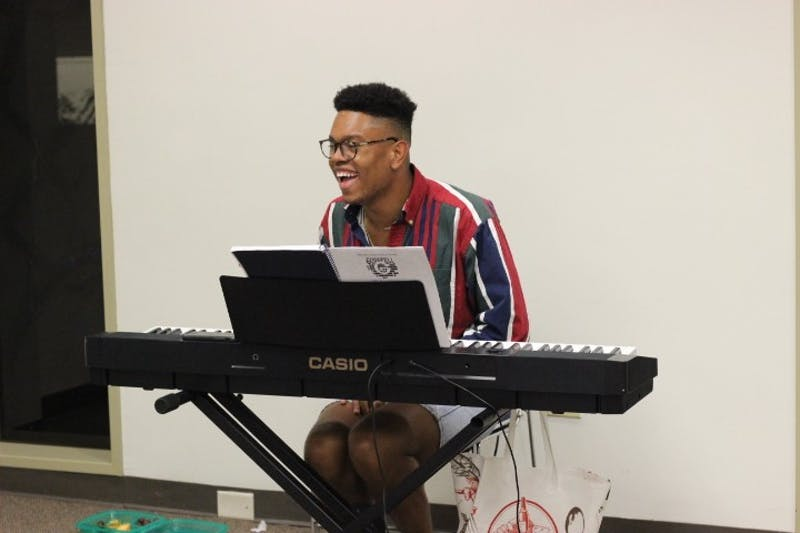Phillip Riddick plays piano for his cast during a rehearsal for Company Carolina's upcoming production of Godspell. Riddick is the director of the play which opens on Nov. 1, 2018.