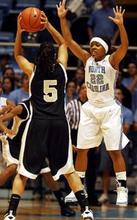 Cetera DeGraffenreid plays defense against Wake Forest's Courteney Morris.