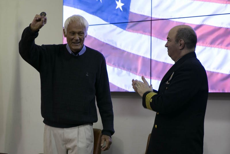 Retired US Marine Corps Captain Larry Greenwold accepts a token from Captain Marc Stern at the annual Veterans' Day Ceremony hosted by UNC RTOC at the UNC NROTC Naval Armory Monday, Nov. 12, 2018.