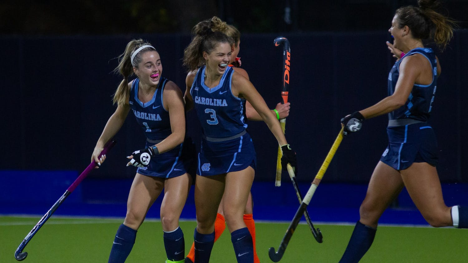 Members of the UNC Field Hockey team celebrate after junior forward Erin Matson (1) scores the second goal of the game against Syracuse. The Tar Heels won the ACC Semifinals with a 4-3 score on Friday, Nov. 6, 2020.