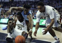 UNC first-year forward Nassir Little (5) dives to recover the ball in No. 8 UNC's 95-57 win over Wake Forest on Saturday, Feb. 16, 2019 at Lawrence Joel Veterans Memorial Coliseum.