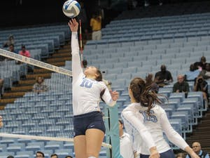 Redshirt sophomore Hunter Atherton reaches to hit the ball in UNC's 3-0 loss against Pittsburgh on Oct. 12.