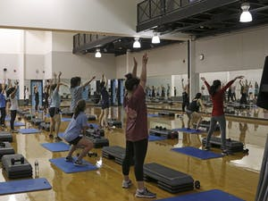 Students, faculty and employees participate in exercise classes in the Student Recreation Center on Tuesday.