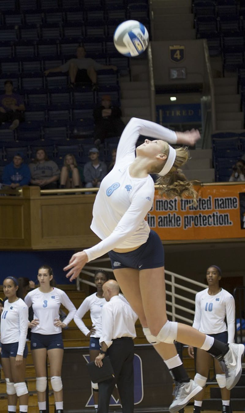 UNC outside hitter Lauren McAdoo (8) serves the ball during Sunday's 3-0 win against Duke at Cameron Indoor Stadium.