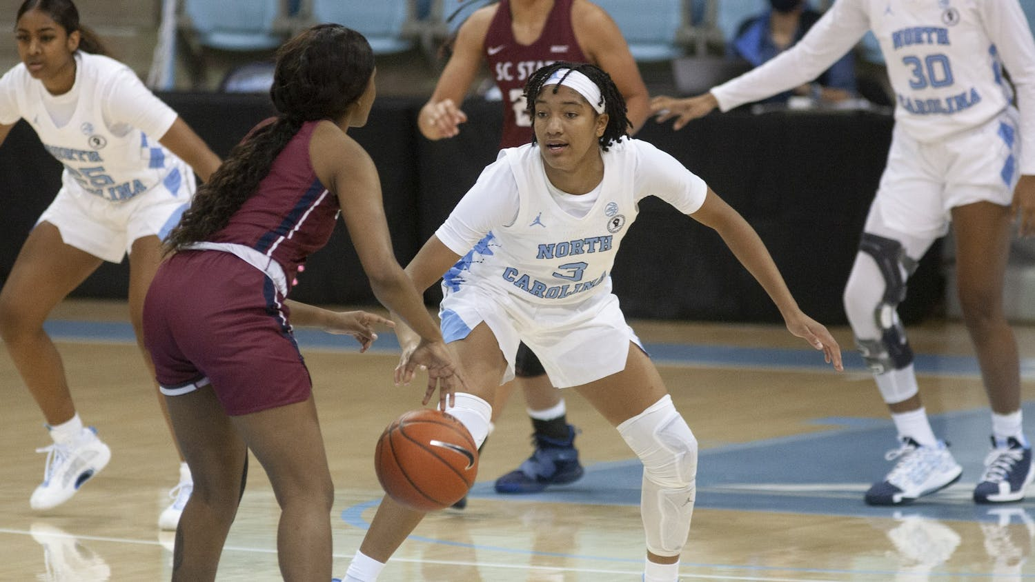 First-year guard Kennedy Todd-Williams (3) drives the ball upcourt against South Carolina State in Carmichael Arena on Dec. 3, 2020. UNC beat SC State 98-28.