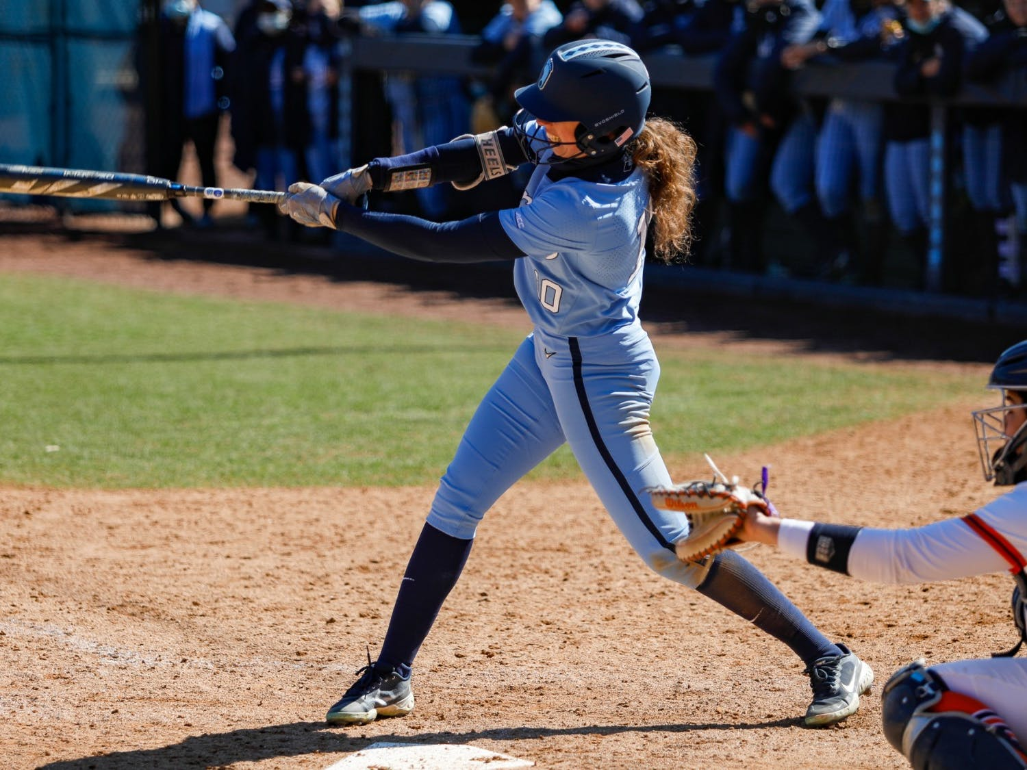 UNC redshirt senior Kristina Burkhardt (10) takes a swing in Anderson Softball Stadium in Chapel Hill, NC on Feb. 20, 2021. The Syracuse Orange beat the Tar Heels 3-2.