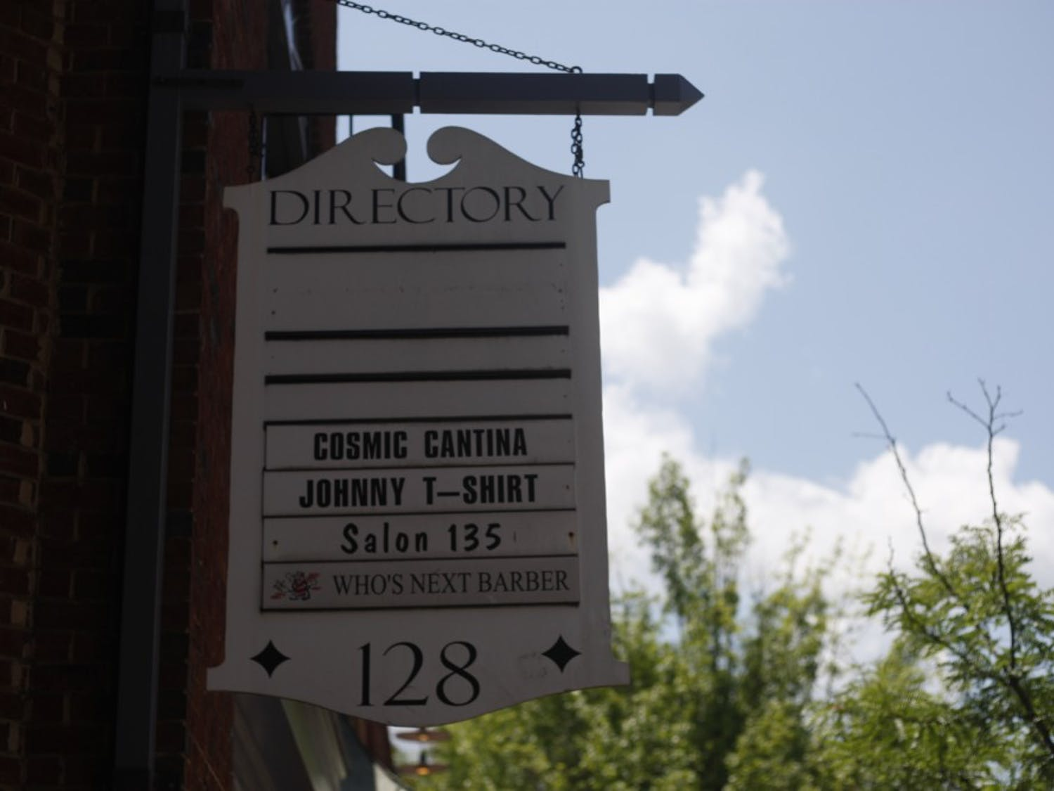The sign for Cosmic Cantina hangs above Franklin St. on Thursday, July 11, 2019.