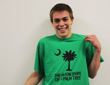 """Sophomore David Hill participated on Wheel of Fortune. His mom made him this humorous shirt after he accidentally answered a puzzle as """"the moon shape of a palm tree"""" instead of """"the cool shade of a palm tree."""""""
