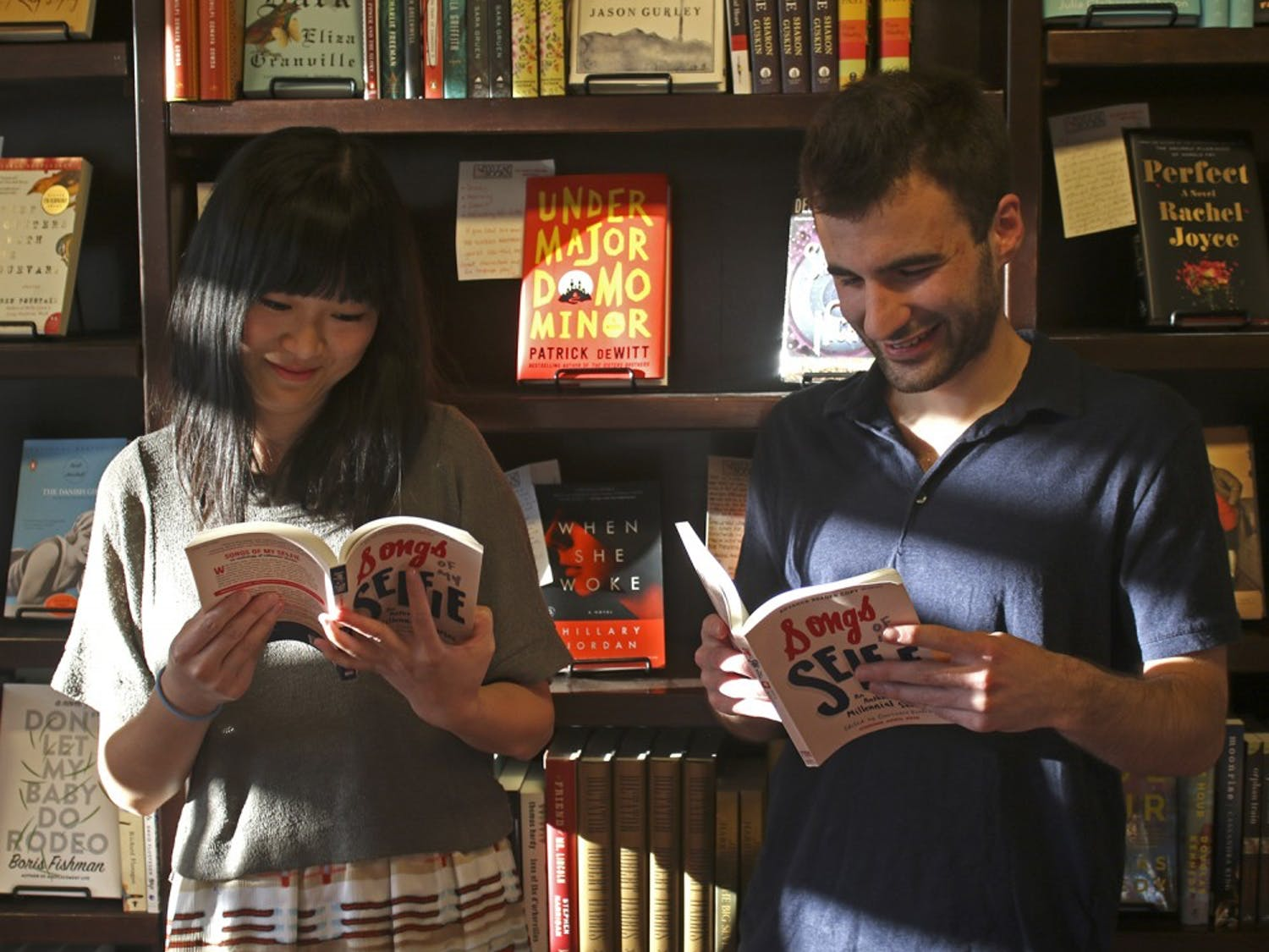 "UNC senior Sarah He (left) and graduate Jared Shaffer read the book they both contributed chapters too, ""Song of my Selfie"". They both spoke at FlyLeafs Books bookstore in Chapel Hill on Monday."
