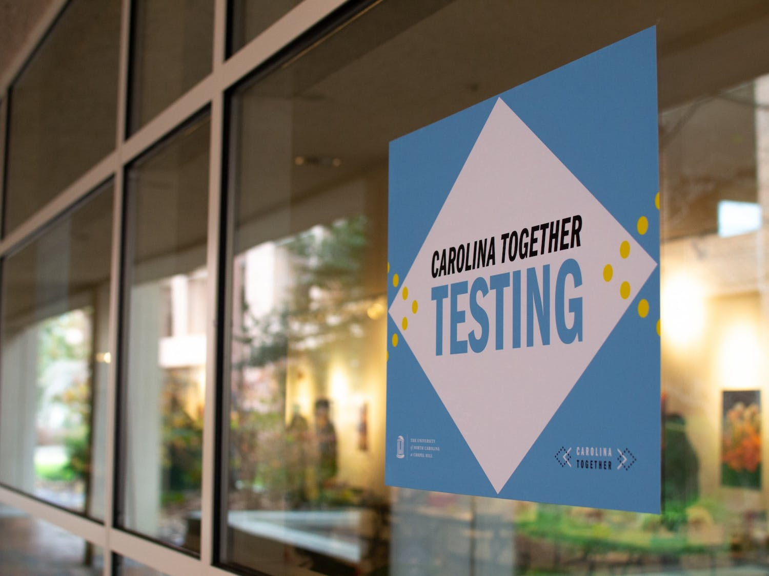 Signage for students receiving their re-entry COVID test at the Frank Porter Graham Student Union is displayed in the gallery space on January 16, 2021.