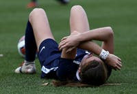 UNC senior defender Julia Ashley lays on the ground in anguish following UNC's 1-0 loss to Florida State in the National Championship game at Sahlen's Stadium at WakeMed Soccer Park in Cary on Dec. 2, 2018.