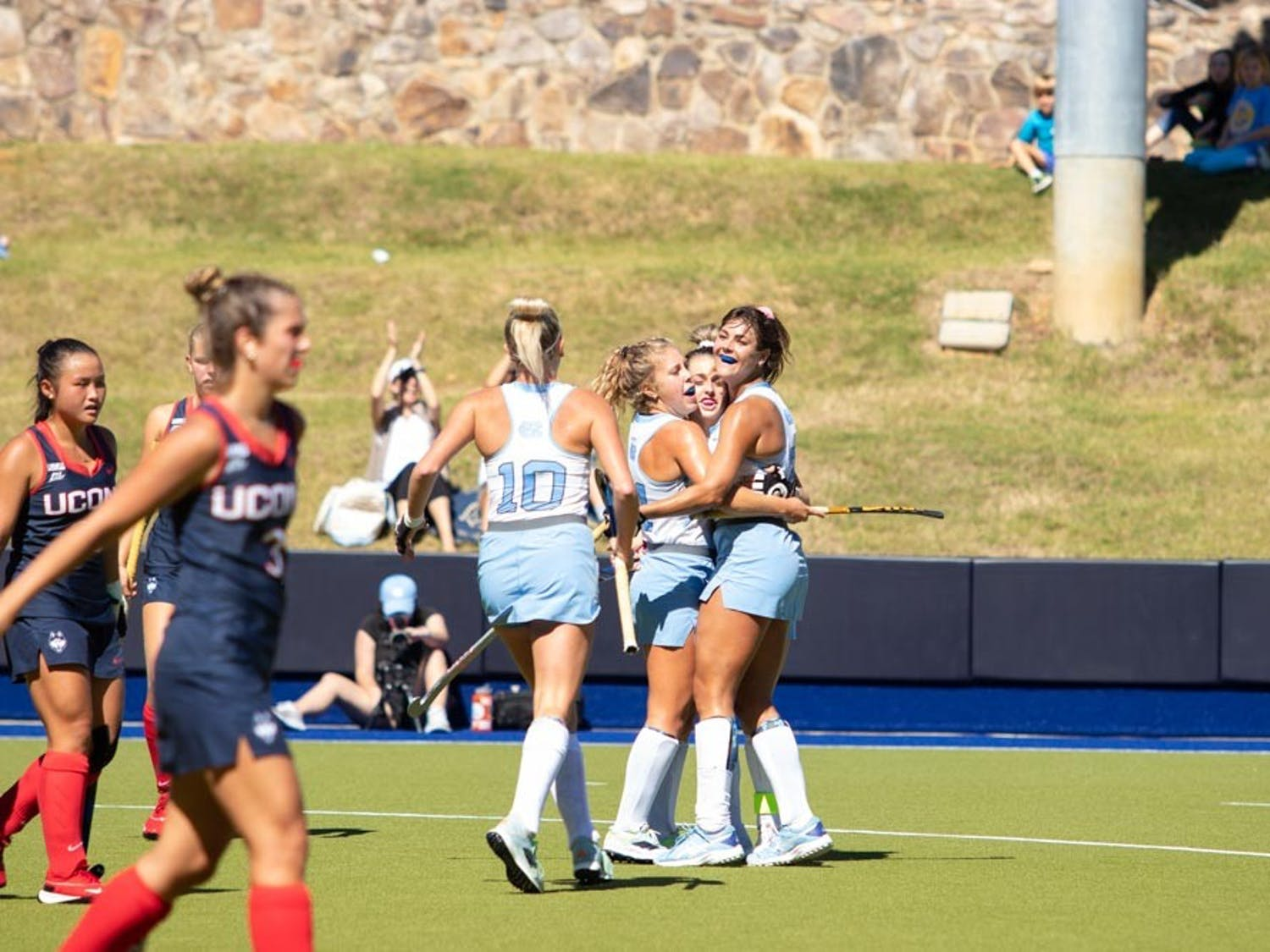 UNC's field hockey team celebrates a goal during their Sept. 26 match against UConn. UNC won 3-1