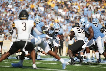 UNC junior running back Michael Carter (8) races downfield during a game in Kenan Memorial Stadium on Saturday, September 21, 2019. The Tar Heels lost to the Mountaineers 31-34 in their second consecutive loss.