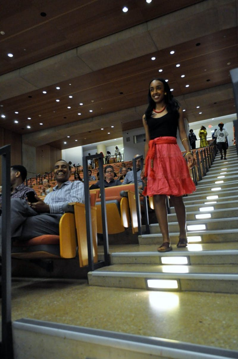 Incoming UNC Master's in Public Health student Shewit Weldense models modern day Kunama clothing at an Eritrean Fashion Show sponsored by Campus Y and the GPSF on Wednesday, April 24, 2019 at the Genome Sciences Building.