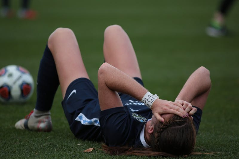Senior defender Julia Ashley (16) lays on the field after losing 0-1 against Florida State in the NCAA Championship on Sunday, Dec. 2, 2018 at WakeMed Soccer Park.