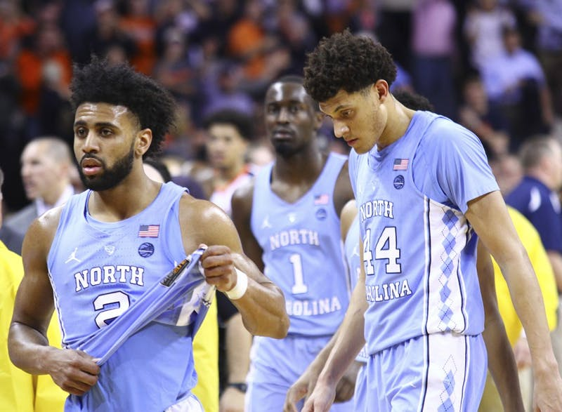 North Carolina guard Joel Berry (2) and wings Justin Jackson (44) and Theo Pinson (1) walk back to the locker room after losing to Virginia on the road on February 27th.