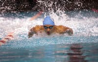 Alvin Jiang competes in the men's 100 yard butterfly event during the swim meet at N.C. State on 19 Jan. 2019. Both the men and women's teams lost to N.C. State.
