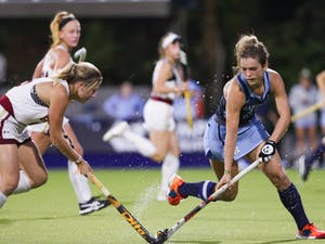 UNC senior midfielder Yentl Leemans (18) takes control of the ball from a Boston College player during a game in Karen Shelton Stadium on Friday, Oct. 25, 2019. The Tar Heels beat Boston College 3-2.