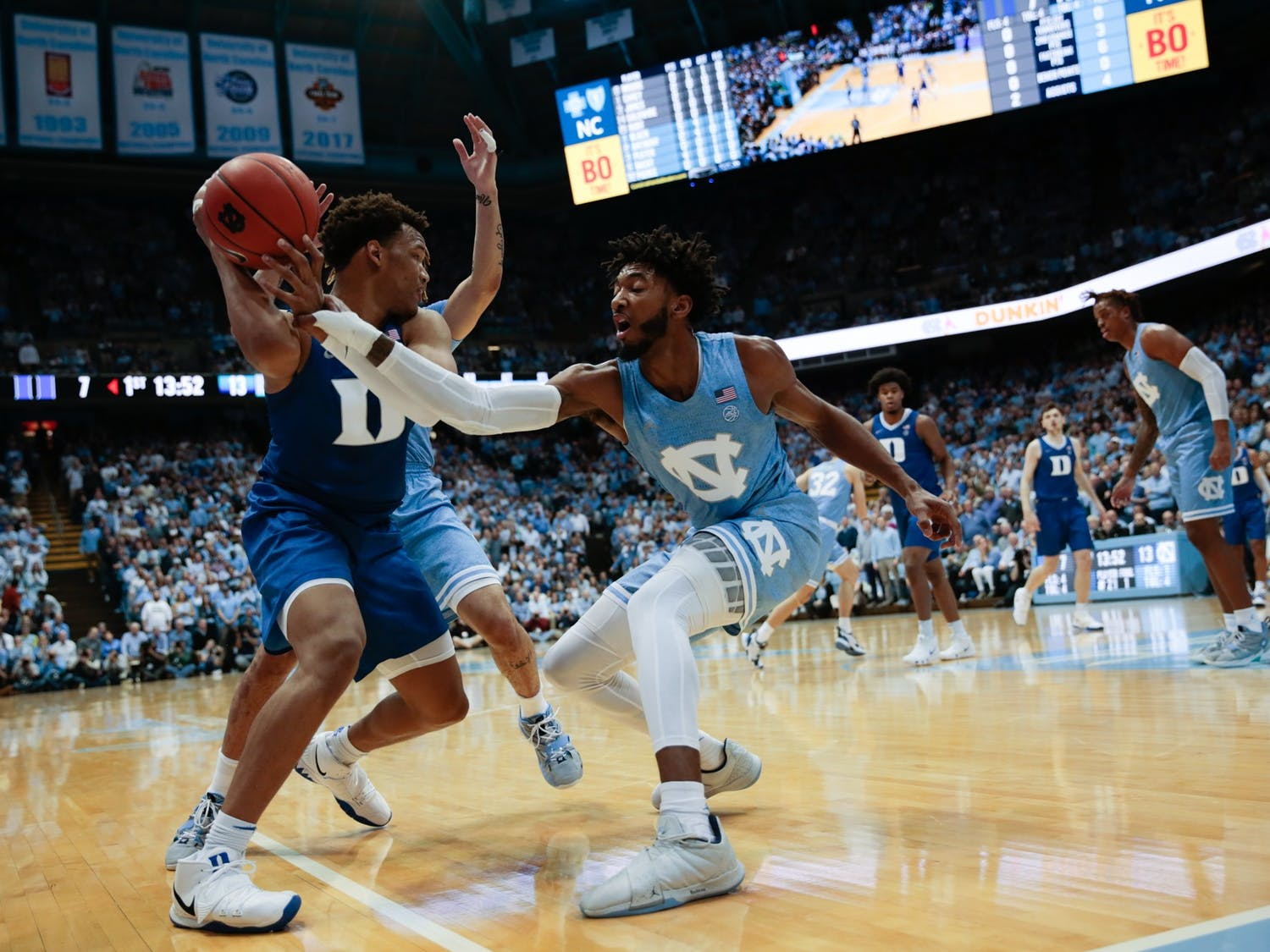UNC sophomore Leaky Black attempts to steal the ball from a Duke player during the rivalry game in the Smith Center on Saturday, Feb. 8, 2020.