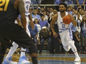 UNC guard Joel Berry (2) dribbles the ball up the court against Long Beach State on Nov. 15.