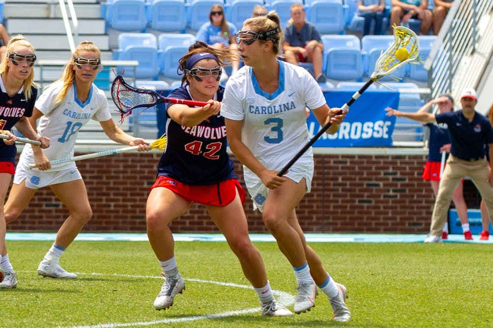 UNC senior attacker Jamie Ortega (3) runs with the ball at the quarterfinals of the NCAA tournament against Stony Brook at the Dorrance Field in Chapel Hill on Saturday May 22, 2021. The Tar Heels won 14-11.