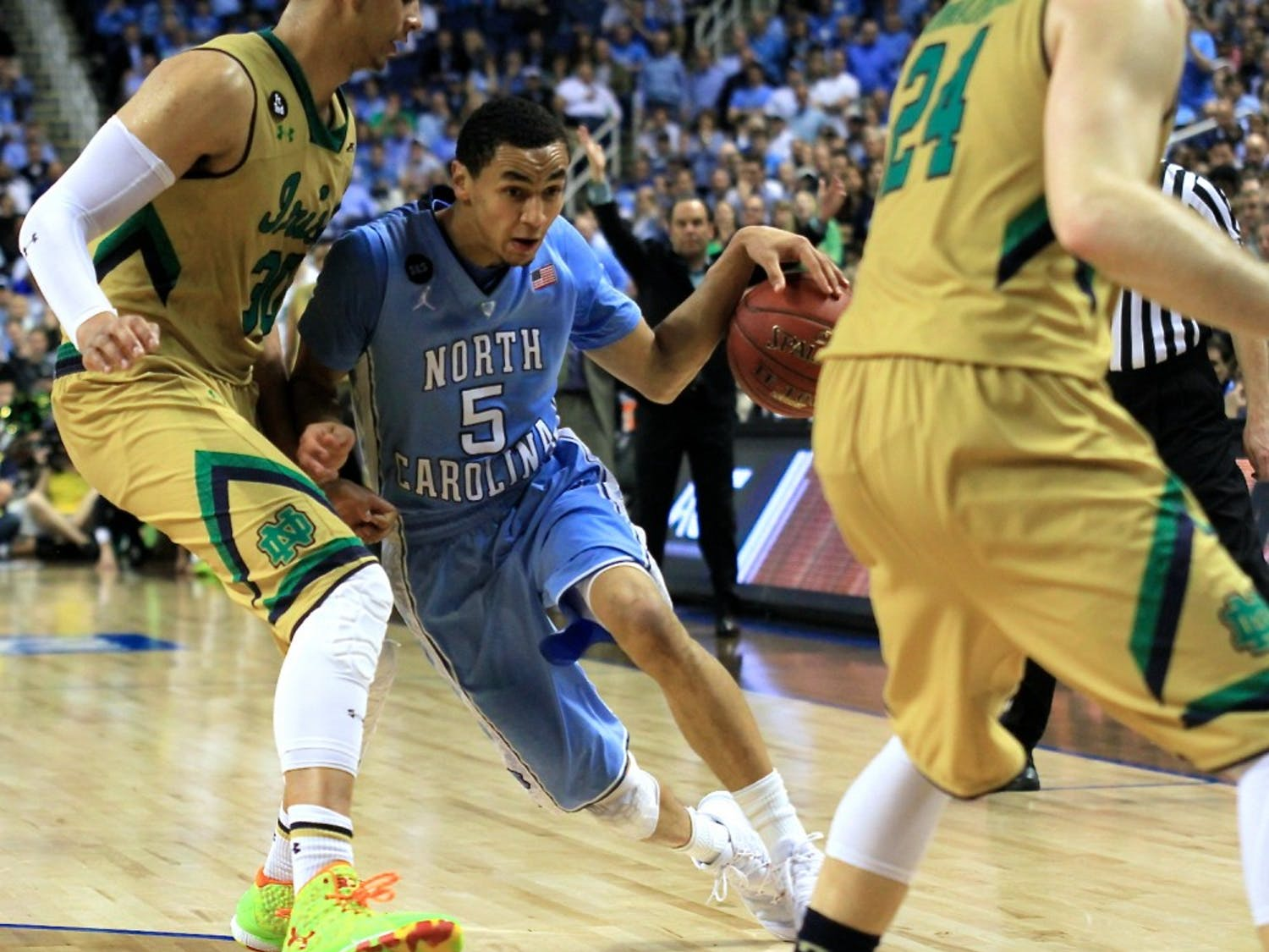 Marcus Paige (5) led the Tar Heels in points, scoring 24 total, Saturday night in the ACC championship game against Notre Dame. The Notre Dame leading scorer, Jerian Grant (22), also scored 24 points.