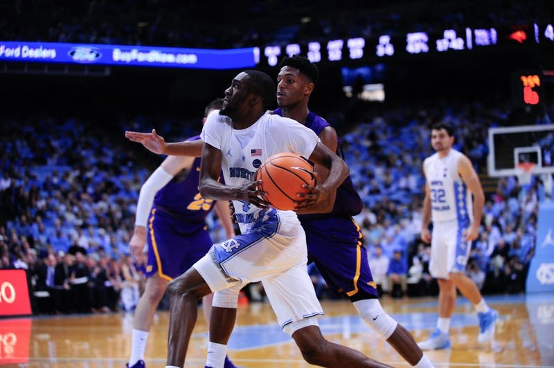 Sophomore Brandon Robinson (4) drives to the basket.